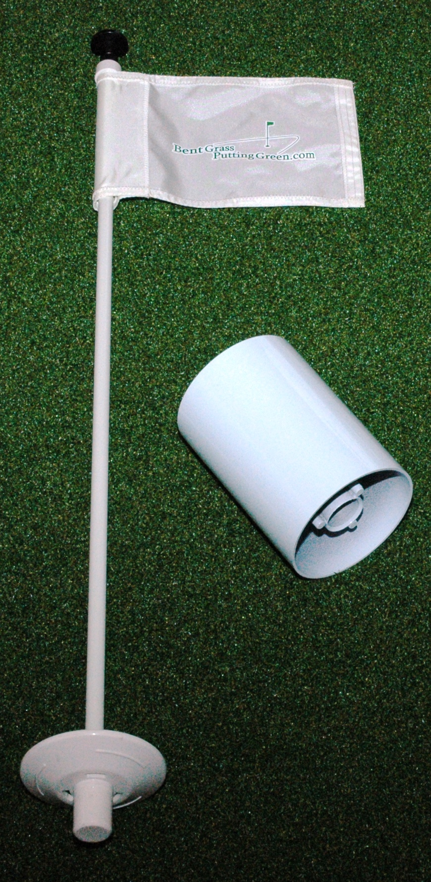Putting green, cups, flag, sticks